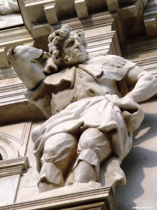 photo of Venice statue with itchy back outside church of Santa Maria dei Derelitti